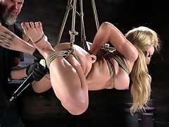 Tied Up And Suspended Seductress Cherie Deville Gets Her Cootchie Toyed