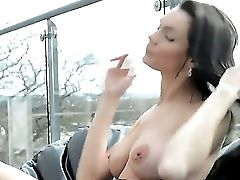 Arousing And Sensuous Dark Haired Kyla Fox Strips And Does Her Amazing Solo Act On The Couch