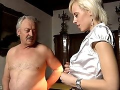 Trampy Doll In A Satin Half-top Blows A Indeed Old Man
