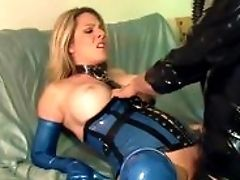Bossy Blonde Fucked On A Couch In Spandex Gloves A Corset And Stockings